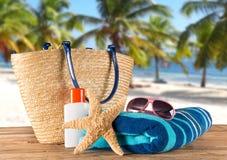 Summer accessories on sandy beach. Stock Photos