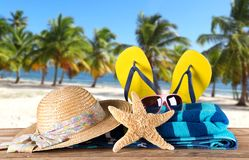 Summer accessories on sandy beach. Royalty Free Stock Images
