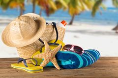 Summer accessories on sandy beach. Royalty Free Stock Photo