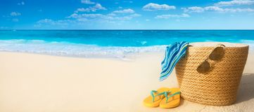 Summer accessories on sandy beach Royalty Free Stock Images