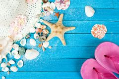 Summer accessories and shells. On blue wooden background Stock Photos