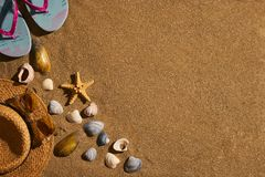 Summer accessories straw hat, glasses, shoes at the beach sand Royalty Free Stock Photo