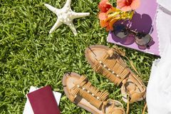 Summer accessories. Summer and travel accessories on grass royalty free stock photo