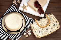 Summer accessories, sun glasses, bag and top striped shirt Royalty Free Stock Photos