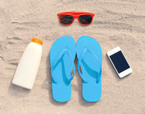Summer accessories sunglasses and flip flops with sunscreen bottle smartphone lie on sand beach Stock Image