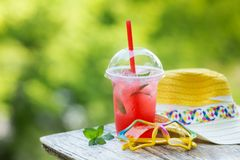 Summer accessories, sunglasses, hat and drink. royalty free stock image