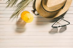 Summer accessories, sunglasses, hat and drink. stock photo