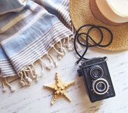 Summer accessories on white marble. Royalty Free Stock Photo