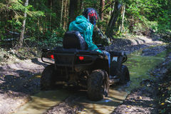 Summer Activities for adults - a trip on quad bikes on the dirty road. Stock Photography