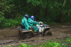 Summer Activities for adults - a trip on quad bikes on the dirty road. Royalty Free Stock Image