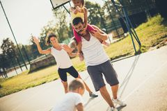 Summer activities. Family playing basketball stock photography