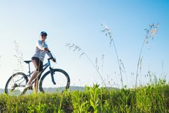 Summer activity: woman ride a bicycle Royalty Free Stock Images