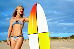 Summer Adventure. Water Sports. Surfing. Healthy Surfer Girl. Summer Adventure. Water Sports. Surfing. Sexy Sporty Surfer Girl With Fit Body In Bikini With Stock Photo