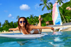 Summer Adventure. Water Sports. Woman Surfing In Sea. Travel Vac