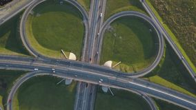 Summer aerial footage of transport junction, traffic cross road junction day view from above. Summer aerial drone footage of transport junction, traffic cross stock video footage