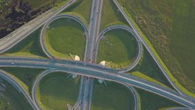 Summer aerial footage of transport junction, traffic cross road junction day view from above. Summer aerial drone footage of transport junction, traffic cross stock video