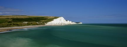 Summer afternoon light on the Severn Sisters white cliffs and the Coast Guard cottages at Cuckmere, in the South Downs National royalty free stock photos
