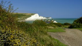 Summer afternoon light on the Severn Sisters white cliffs and the Coast Guard cottages at Cuckmere, in the South Downs National royalty free stock images