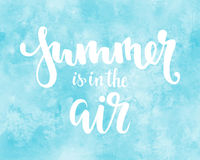 Summer is in the air. Hand drawn calligraphy and brush pen lettering. design for greeting card and invitation of seasonal summer h Royalty Free Stock Photo