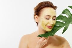 Summer anti aging collagen mask on middle age woman wrinkle face isolated on white background. Skin care spa and menopause concept. Copy space stock photos