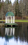 A summer arbour with white columns is ashore lake Royalty Free Stock Photos