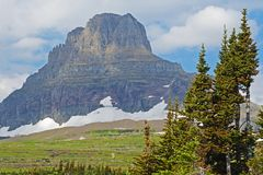 Glaciers still lay frozen in summer in Glacier National Park. Royalty Free Stock Image