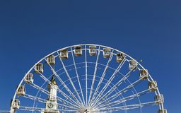 Attraction ferris wheel from the height of man. Summer attraction for those who are not afraid of heights Royalty Free Stock Photo