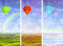 Summer, autumn, winter rolling landscapes. Beautiful summer, autumn and winter rolling landscapes with colorful hot air balloons flying above Stock Photo
