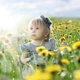 Summer baby girl on grass outdoors Royalty Free Stock Photography