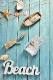 Summer bacground with beach accessories on blue wooden board Royalty Free Stock Photos