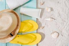 Summer background. Beach accessories flip flops, sunglasses, hat. And orange juice on wooden deck stock photography