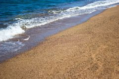 Summer background - beach with golden sand and sea waves Stock Images