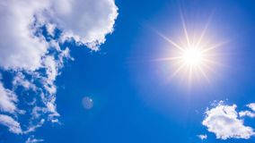 Summer background with blue sky and bright sun Stock Photo
