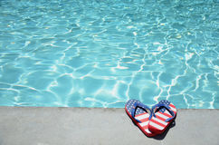 Summer background with flip flops near the pool royalty free stock photography