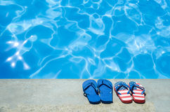 Summer background with flip flops near the pool stock images