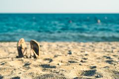 Summer background with flip flops on a sandy beach royalty free stock images