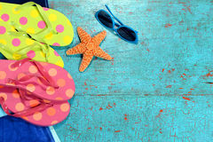 Summer Background with Flip-flops, Sunglasses and Starfish Royalty Free Stock Photography
