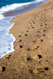 summer background - footprints on the beach with golden sand Royalty Free Stock Photos