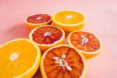 Summer background half of citrus. Creative summer pink background royalty free stock images