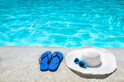 Summer background with hat, flip flops and sunglasses near the p Stock Images