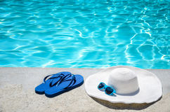 Summer background with hat, flip flops and sunglasses near the p Royalty Free Stock Images