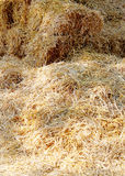 Summer background of hay from stack. Haystack closeup as a backg Stock Photos