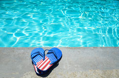 Summer background with heart of flip flops near the pool stock images