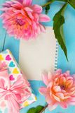 Summer background. light pink dahlias on a wooden blue background, royalty free stock photo