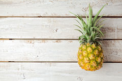 Summer background with pineapple on wooden board Royalty Free Stock Photos