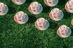 Summer background Pink sunhat on green grass. Pop art, creative summer party concept. Minimalism. Summer background Pink sunhat on green grass background. View stock photo