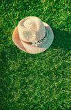 Summer background Pink sunhat on green grass. Pop art design, creative summer party. Minimalism. Summer background Pink sunhat on green grass background. View stock photography