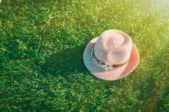Summer background Pink sunhat on green grass. Pop art design, creative summer party. Minimalism. Summer background Pink sunhat on green grass background. View royalty free stock images