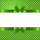 Summer background with polka dots, with a green bow and place fo Royalty Free Stock Photos