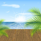 Summer background. Sea view, wooden floor and palm leaves. Stock Image